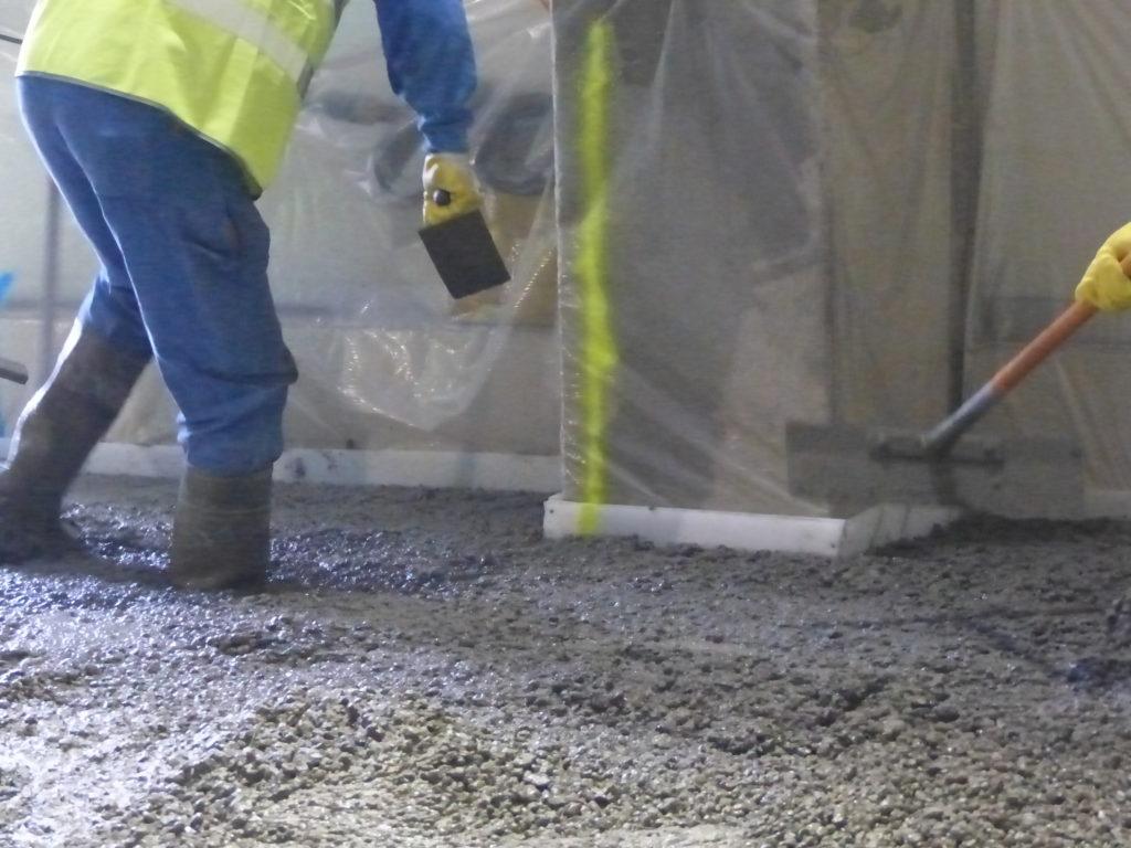 man installing concrete floor