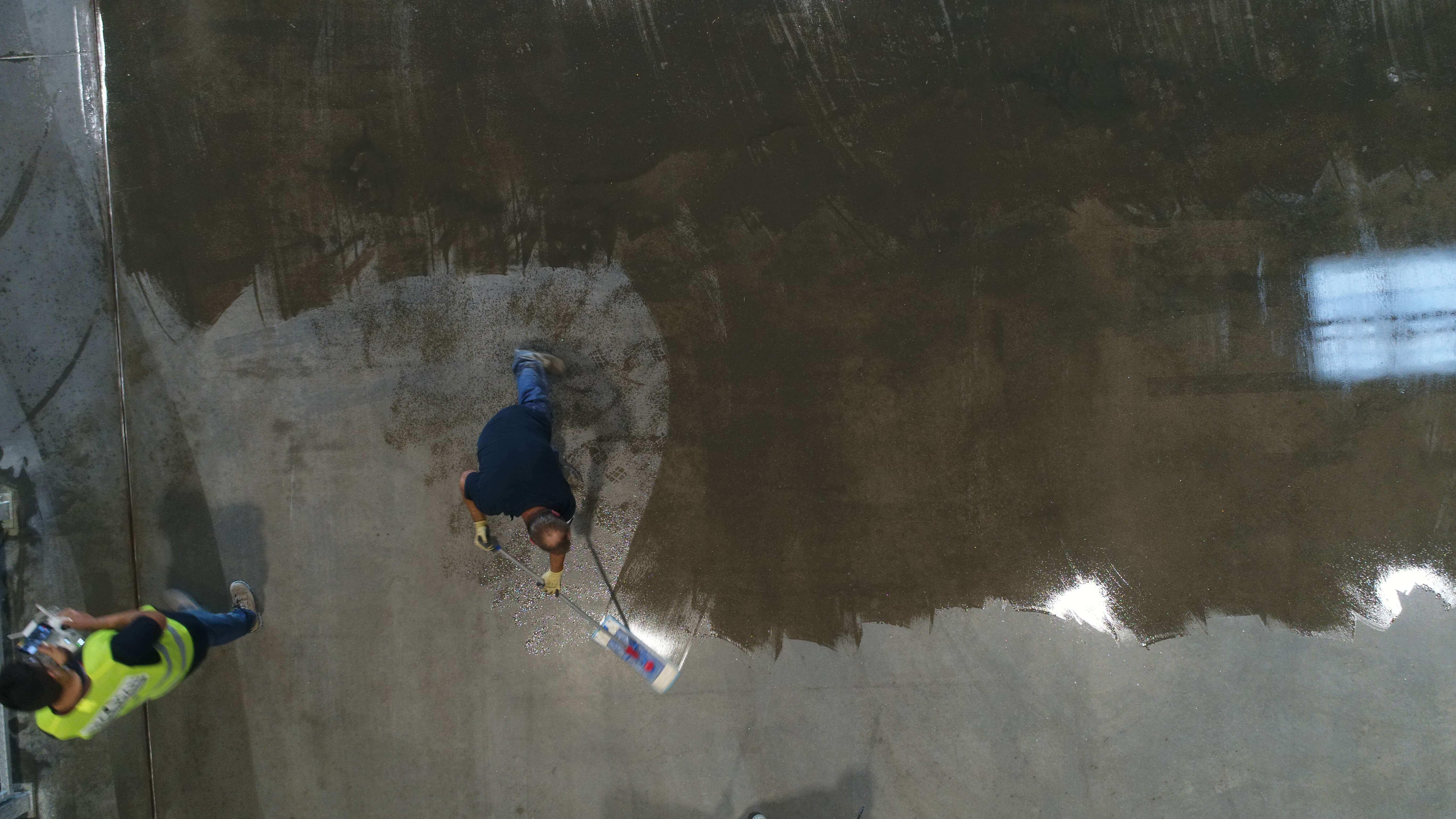 applying protective sealer into concrete