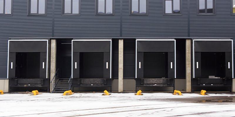 Sectional doors in loading docks